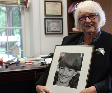 Nancy Brown holds a photo of her son, Will Brown, now serving overseas