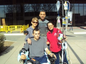 Cpl. Farrell Gilliam with his grandmother, Theresa Stavens, brother Daniel Lorente, and mother Lisa Gilliam in Bethesda, Maryland March 2011 on Gilliams first outing from the hospital. Courtesy photo